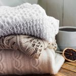 cozy blankets next to a cup of coffee