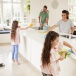 Family cleans kitchen together